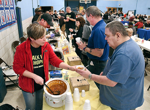 John P. Cleary   The Herald Bulletin<br /> Nine teams competed in the Walk For Hope Addiction Awareness Chili Cook-Off Saturday here passing out cups of their offerings hoping for being judged the best chili.