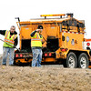John P. Cleary | The Herald Bulletin<br /> Patching crews worked filling potholes Wednesday afternoon along northbound I-69 near the 226 Scatterfield exit after numerous reports of flat tires that were caused by vehicles hitting them.