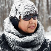 John P. Cleary | The Herald Bulletin<br /> Norma Rakes has collected a bunch of snow on herself as she snow blows off her driveway on Mounds Road Friday morning after an overnignt snowfall.