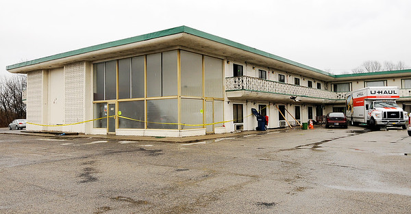 Don Knight | The Herald Bulletin<br /> Residents move out of the Economy Inn in Anderson after it was condemned on Thursday.