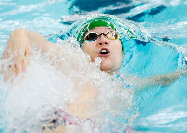 Don Knight   The Herald Bulletin<br /> Pendleton Heights Evan Fredericks competes in the 100 backstroke preliminary during the boys swimming sectional at Hamilton Southeastern on Thursday. Fredericks finished seventh and qualified for the finals.