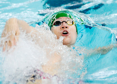 Don Knight | The Herald Bulletin Pendleton Heights Evan Fredericks competes in the 100 backstroke preliminary during the boys swimming sectional at Hamilton Southeastern on Thursday. Fredericks finished seventh and qualified for the finals.