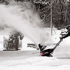 John P. Cleary | The Herald Bulletin<br /> Norma Rakes kicks up a big plume of snow as she cleans off her driveway along Mounds Road Friday morning after about five inches of snow fell overnight.