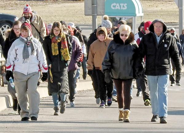 """Mark Maynard   The Herald Bulletin<br /> Stalwart supporters of the Anderson Christian Center bundled up against the cold for the annual """"Walk a Mile in My Shoes"""" fundraiser on Saturday morning."""