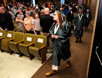 Don Knight | The Herald Bulletin Mikaela Klujeske-Rodriquez walks in the procession during the Excel Center's graduation at the Anderson City Building on Friday.