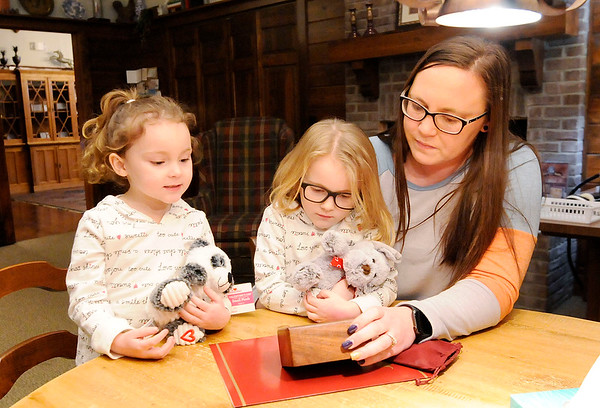 Don Knight | The Herald Bulletin<br /> Kayla Byrne wither her daughters, from left - Braylee and Brinklee Denny, picks up the cremated remains of her dog Princess at Loyal and True, a pet cremation service offered by Loose Funeral home.