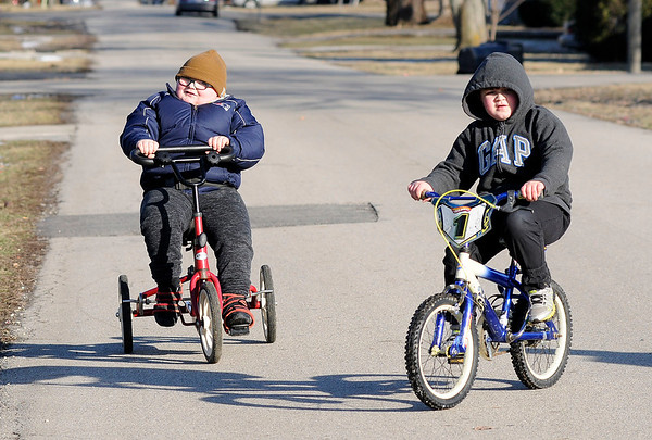 Don Knight | The Herald Bulletin Trenton Brown rides bikes with his brother Braxton on Wednesday. When Trenton was diagnosed with Schizencephaly, his parents were told he would likely remain in a vegetative state, but he is living an active life including riding his Rifton Adaptive Tricycle.