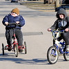 Don Knight | The Herald Bulletin<br /> Trenton Brown rides bikes with his brother Braxton on Wednesday. When Trenton was diagnosed with Schizencephaly, his parents were told he would likely remain in a vegetative state, but he is living an active life including riding his Rifton Adaptive Tricycle.