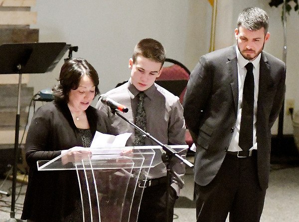 John P. Cleary | The Herald Bulletin<br /> Amanda Cooper, mother of Aiden Ayres, speaks at her son's funeral Friday as brother Dylan Ayres and father Douglas Ayres stand by her. The 15-year-old Shenandoah High School sophomore was battling depression and took his own life.