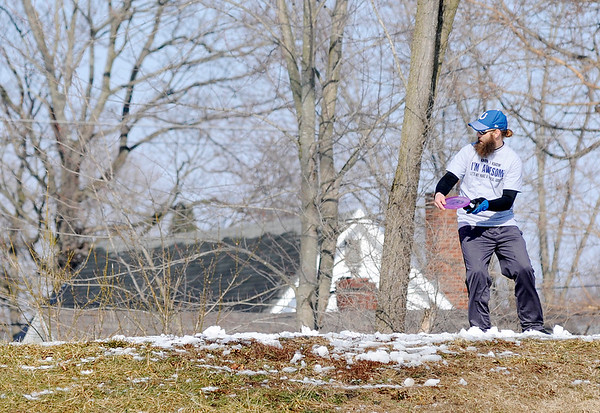 Don Knight | The Herald Bulletin<br /> Disc golfers get in a practice round at the Sanders Memorial Disc Golf Course at Edgewater Park on Saturday.