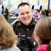John P. Cleary | The Herald Bulletin<br /> Madison County Sheriff's Department DARE officer Darren Dyer makes his rounds talking with students during their lunch period at Maple Ridge Elementary School.