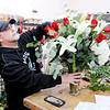 Don Knight | The Herald Bulletin<br /> David Schwartz works on an arrangement of roses, white lilies, calla lilies, hydrangeas and silver dollar eucalyptus in preparation for Valentines Day at Toles Flowers on Wednesday.