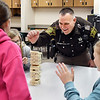 John P. Cleary | The Herald Bulletin<br /> Madison County Sheriff's DARE officer Darren Dyer plays Jenga with these Maple Ridge Elementary School fifth-graders during their indoor recess this past week.