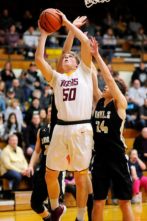 Don Knight   The Herald Bulletin<br /> Alexandria's Miller Abernathy shoots from the low post as the Tigers hosted the Madison-Grant Argylls on Saturday.