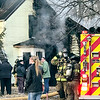 Several people gathered outside a home in the 600 block of Indiana Avenue just after 5 p.m. on Monday. A neighbor, who declined to be identified, said a dog was rescued from the residence. Anderson Fire Chief Dave Cravens said he would have more details on Tuesday regarding the fire on Indiana Avenue and that of two other fires that occurred in Anderson on Monday.