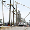 John P. Cleary | The Herald Bulletin<br /> Gaylor Electric workers use multiple booms as they install larger power poles along Layton Road near 400 South in the Flagship Enterprise Center Tuesday afternoon.