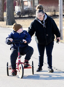 Don Knight | The Herald Bulletin Trenton Brown rides his Rifton Adaptive Tricycle next to his mom Kelly Brown on Wednesday.