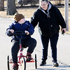 Don Knight | The Herald Bulletin<br /> Trenton Brown rides his Rifton Adaptive Tricycle next to his mom Kelly Brown on Wednesday.