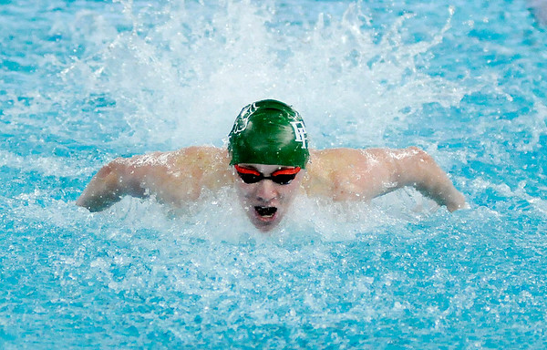 Don Knight   The Herald Bulletin<br /> Pendleton Heights Cameron Kordes competes in the 100 butterfly during the boys swimming sectional preliminaries at Hamilton Southeastern on Thursday.