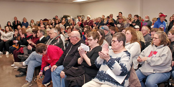 Mark Maynard | For The Herald Bulletin<br /> Members of the audience react with applause upon hearing that Casey Smitherman submitted her letter of resignation as School Superintendent, which was accepted by the trustees.