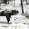 Don Knight | The Herald Bulletin<br /> Students walk across the vally as a steady rain fell at Anderson University on Wednesday. The forecast is calling for sunshine to return for the end of the work week.