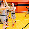 Don Knight | The Herald Bulletin<br /> Payton Moore high fives her teammates as the Anderson University starters are introduced on Saturday. The Ravens hosted Transylvania for a men's and women's double header on Saturday.