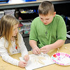Don Knight | The Herald Bulletin<br /> From left, kindergarten student Elsy Mann and fourth grader Cooper Rudy uses toothpicks and marshmallows to create a home for Cupid at Summitville Elementary students on Thursday. Students from Samantha Smith's kindergarten class and Kandi Pretorius' fourth grade class are teamed up and come together once a week.