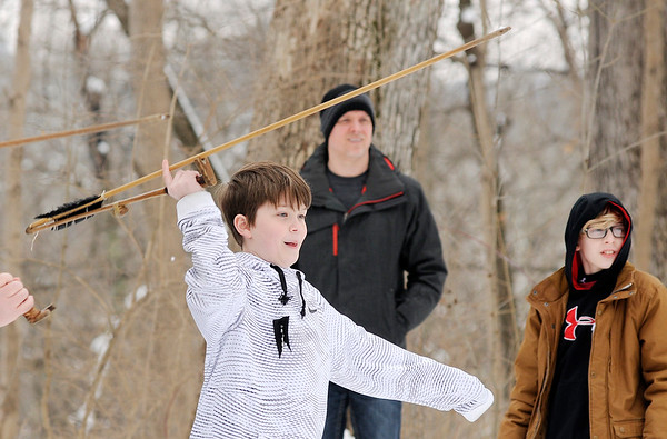 Don Knight | The Herald Bulletin<br /> Bo Pitcock, 12, uses an atlatl to throw a dart during Mounds State Park's  School of Wizardry and Wildlife on Saturday.