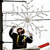 John P. Cleary | The Herald Bulletin<br /> Zach Conkle, of Anderson Municipal Light & Power, removes the city's holiday snowflake decorations from downtown light poles along Main Street<br /> Monday morning. With the snowflakes coming down could this be another sign of a early spring to go with Punxsutawney Phils' prognostication of the same?