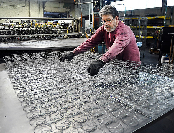 John P. Cleary | The Herald Bulletin<br /> Barber Manufacturing celebrating 125 years in business in Anderson. Brummett Gray checks these springs after they have come out of the machine that puts together the individual springs into this large piece.