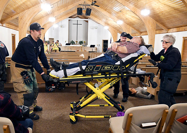 John P. Cleary   The Herald Bulletin<br /> Emergency medical personnel remove a gunshot victim from the sanctuary of Lone Oak Wesleyan Church Monday evening after a active shooter stormed the church and started firing.  This was all part of a training session for the Lapel and Edgewood police and fire departments.