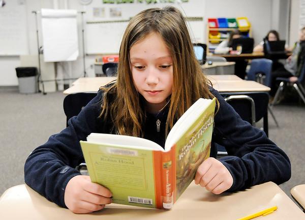 Don Knight | The Herald Bulletin Reese Box reads Robin Hood in Allison Gill's sixth grade class at Summitville Elementary on Thursday.