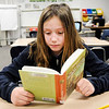 Don Knight | The Herald Bulletin<br /> Reese Box reads Robin Hood in Allison Gill's sixth grade class at Summitville Elementary on Thursday.