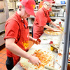 Don Knight | The Herald Bulletin<br /> From left, Kayla Stanley and Ursula Koch prepare pizzas for the oven at the <br /> Pizza King on Nichol Avenue.  Pizza King was voted as the best pizza in Madison County by readers of The Herald Bulletin.