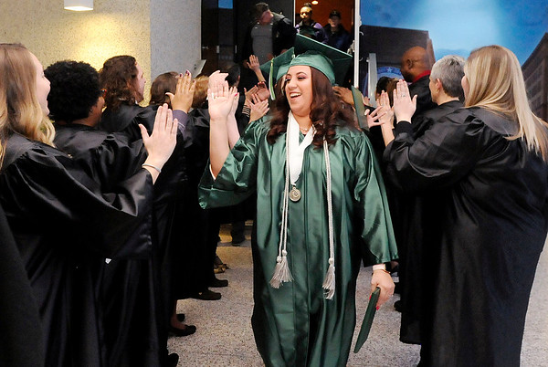 Don Knight | The Herald Bulletin Adela Huffman high fives the Excel Center instructors during her graduation at the Anderson City Building on Friday.