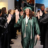 Don Knight | The Herald Bulletin<br /> Adela Huffman high fives the Excel Center instructors during her graduation at the Anderson City Building on Friday.