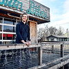 John P. Cleary | The Herald Bulletin<br /> Ben Orcutt stands on the porch of his business Buckskin Bikes with his other business venture, Jackrabbit Coffee, in the background in the 500 block of West 11th Street in Anderson. Orcutt was named entrepreneur of the year for 2018.