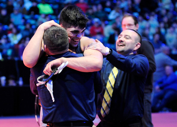 Don Knight   The Herald Bulletin<br /> Shenandoah's Silas Allred wrestles Nick Willham from Greenwood Community in the 195 pound state championship at Bankers Life Fieldhouse on Saturday.