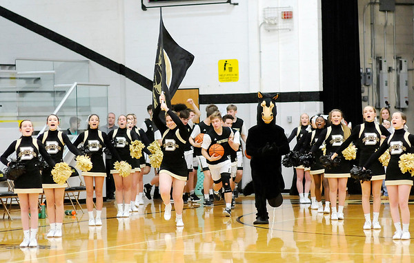 Don Knight   The Herald Bulletin<br /> Cheerleader Eve Emery and mascot David Shellabarger lead the Broncos on to the court as Daleville hosted Alexandria on Tuesday.