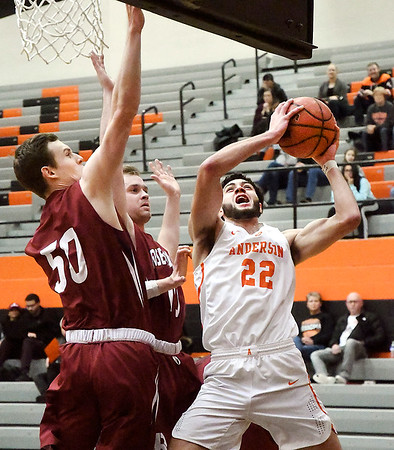 AU's Maurice Knight alters his shot as he drives to the basket as Rose-Hulman defenders try to block.