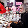 Monica Sampley, of Good's Candy Shop, listens as Frances Kester points out her selections to fill her Valentine box as she shops for Valentine's Day.