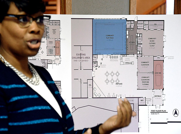 Rev.Tressena Jones, of First Church of the Nazarene, talks about the new community center the church plans to open with the architectural drawing for the facility in the background.