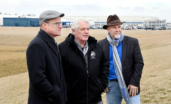 Rob Sparks, executive director Madison County Corporation for Economic Development, Anderson Mayor Thomas Broderick Jr., and Greg Winkler, Anderson Economic Development executive director, shown in front of the NTN and Interstate Warehousing facilities on Layton Road.