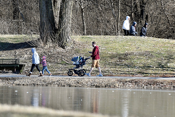 People took advantage of the warmer temperatures and abundant sunshine over the weekend to get outdoors and enjoy both, like these folks taking a good walk along the paths of Pulaski Park.