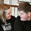 Belinda Bollman has a moment with her son Hunter, 12, while she talks about her late husband, ICO Sgt. Ed Bollman, who died a two years ago while attempting to save his friend while ice fishing.