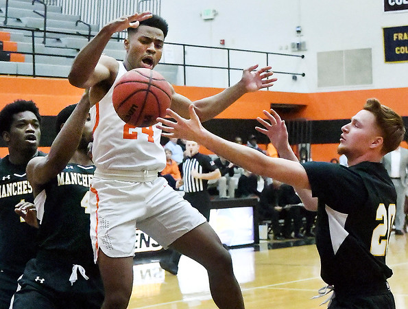 AU's Ronny Williams gets the ball knocked away as he drives the lane against Mahchester.