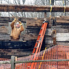 Pendleton Log Cabin Project volunteer Jay Brown works to set this log beam Tuesday as he and others work on the reconstructing the last log cabin in Pendleton. The cabin, which was built in the 1830's, was located on Mill Road on the south side to town in a flood plain. The cabin was purchased and then donated to the Pendleton Parks Department where volunteers have dismantled it and are now reconstructing the structure at the north entrance to Falls Park.