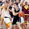 Daleville's Connor Fleming looks for an outlet as he gets boxed in by the Alexandria defense.