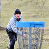 Richard Erb, of Anderson, follows his shot to the basket on the 18th hole of the Sanders Memorial Disc Golf Course at Edgewater Park Monday afternoon. Erb was taking advantage of some free time and the warm temperatures to get outdoors and to get some disc golf in.