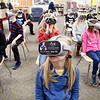 Lapel Elementary School fourth-graders in Holly McClintick's class look around as they wear virtual reality viewers showing the Eva Kor Experience during an Eva Education Program this week at the school.